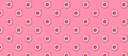 Seamless pattern with Christmas tree toy donut on pink. Holiday season concept, place for text Standard-Bild