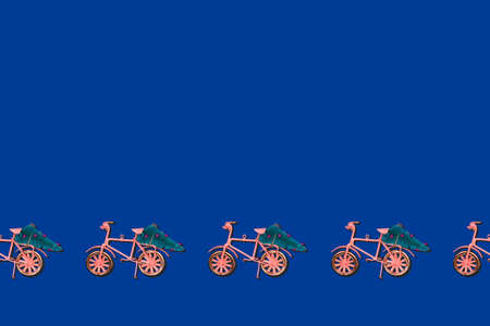 Pattern with bicycle moving Christmas tree on classic blue. Holiday celebration card concept with place for text. Horizontal Standard-Bild - 160518197