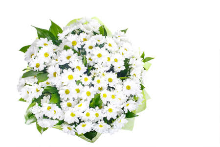 A bouquet of white camomiles, chrysanthemums in a light green package. A holiday, a gift for a woman. Big and smart. View from above. Isolated.