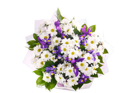 Bouquet of flowers from white chrysanthemums, chamomiles and violet irises, russus, lilac package. Color, contrast. A holiday, a gift for a woman. Smart. View from above. Isolated.