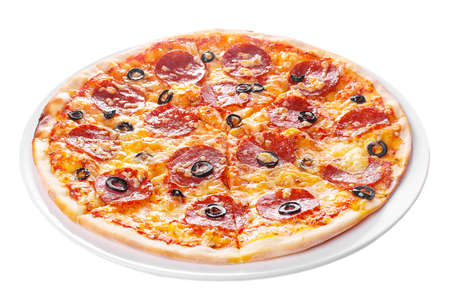 Pizza whole round, cut into pieces, on a white isolated background. Fast food in a pizzeria, a floury cheese product. Side view