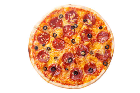Pizza whole round, cut into pieces, on a white isolated background. Fast food in a pizzeria, a floury cheese product. View from above