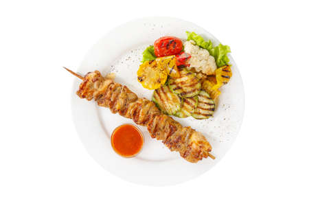 Shish kebab, beef, lamb, pork, chicken grilled meat, barbecue, with side dish vegetables, isolated on white background. Ketchup, tomato, red sauce. View from above For the menu