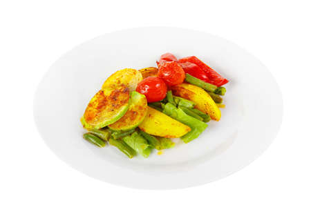 Vegetables grilled portion of side dish on a plate on white isolated background Side view. Appetizing dish for the menu restaurant, bar, cafe