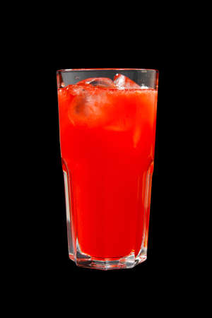 Single-colored, red cocktail in a glass with ice from grapefruit, tomato, strawberry. Side view. Isolated black background. Drink for the menu restaurant, bar, cafe