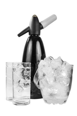 Black shiny metal table siphon for soda, next to a transparent bucket of ice and two glasses of mineral sparkling water, isolated white background, side view, for a menu of restaurants, bars, cafes Stock Photo