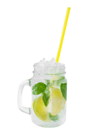 Summer drink, cold tea in a glass jar with lime and mint, ice, straw, on isolated white background, side view, Direct perspective, cool, refreshing, drink for menu