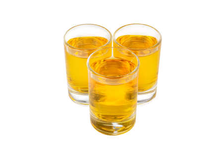 Yellow transparent cocktails, a set of shots pile, wedge, three servings, with taste of lemon, orange, view from above, isolated white background