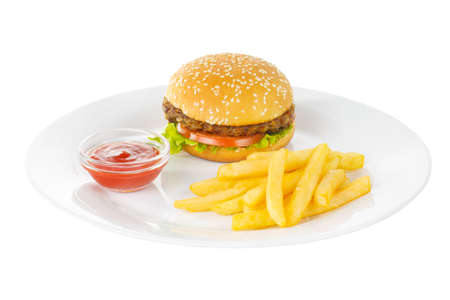 Burger with beef, meat cutlet, tomato, leaf lettuce, French fries and ketchup, barbecue sauce on plate, side view, isolated white background Banco de Imagens