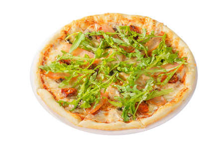 Pizza with arugula, dried tomatoes and mushrooms whole round, cut into pieces, on a white isolated background, side view Banco de Imagens