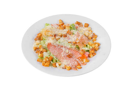 Caesar salad with three kinds of fish lobes, salmon, trout, biscuits, lettuce, cheese on plate, white isolated background, side view 스톡 콘텐츠 - 124995209