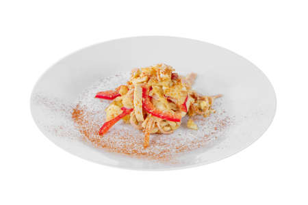 Salad with red Bulgarian pepper, chicken or squid meat, ham, egg, cabbage, potatoes, spicy on plate, white isolated background, side view Banco de Imagens - 124995211
