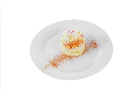 Salad with crab meat, egg, potatoes, spicy on plate, white isolated background, side view Banco de Imagens