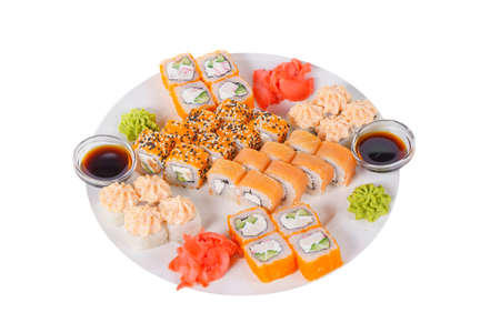 Set of sushi for a large company, rolls, california, philadelphia with lava sauce, marinated ginger and wasabi, white isolated background, side view