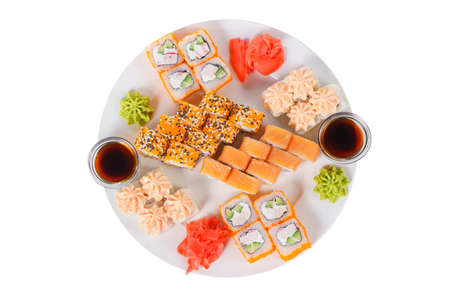 Set of sushi for a large company, rolls, california, philadelphia with lava sauce, ginger and wasabi, white isolated background, view from above Banco de Imagens