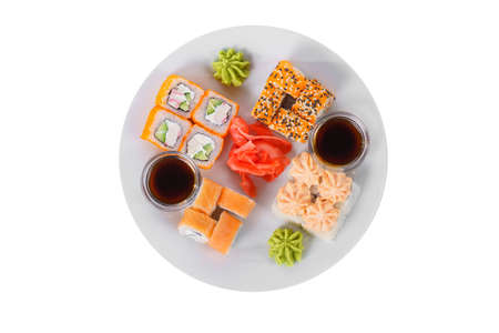 Set of sushi, rolls, uramaki, hosomaki california and philadelphia, lava sauce, ginger and wasabi, white isolated background, view from above Banco de Imagens