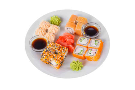 Set of sushi, rolls, uramaki, hosomaki california and philadelphia, lava sauce, marinated ginger and wasabi, white isolated background, side view