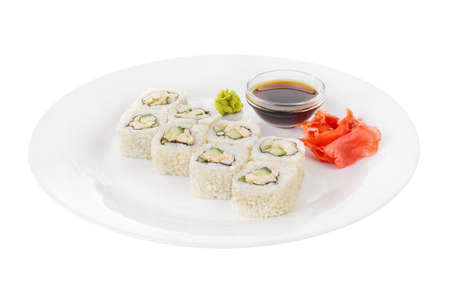 Sushi, rolls, uramaki Alaska, with avocado, cucumber, meat, soy sauce, marinated ginger and wasabi, white isolated background side view Stockfoto