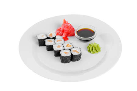 Sushi, rolls, hosomaki with salmon and philadelphia cheese, raw seafood, soy sauce, marinated ginger and wasabi, white isolated background, side view