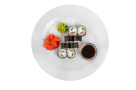 Sushi, rolls, hosomaki with salmon and philadelphia cheese, soy sauce, marinated ginger and wasabi, white isolated background, view from above Banco de Imagens