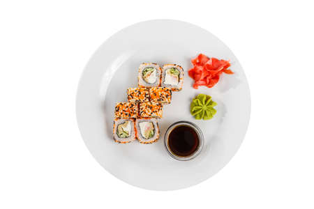 Sushi, rolls, uramaki california with tobiko caviar, soy sauce, marinated ginger and wasabi, white isolated background, view from above