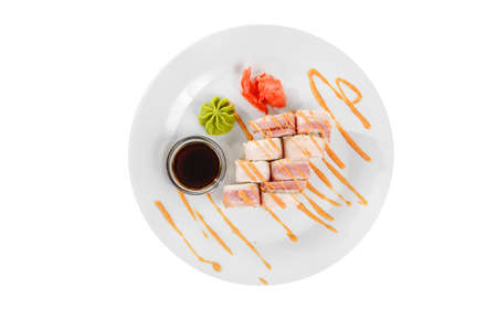 Sushi, rolls, uramaki with bacon, cucumber, cheese, meat and teriyaki sauce, marinated ginger and wasabi, white isolated background, view from above