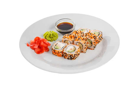 Sushi, rolls, uramaki california with tobiko caviar, soy sauce, marinated ginger and wasabi. Food on plate, white isolated background, side view Stockfoto