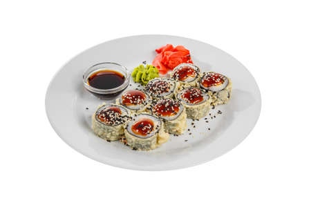 Sushi, rolls, uramaki, tempura with teriyaki sauce, sesame, raw seafood, soy sauce, marinated ginger and wasabi, white isolated background, side view