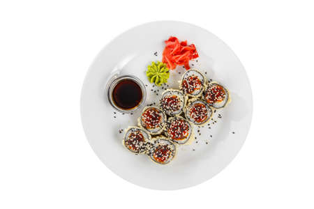 Sushi, rolls, uramaki, tempura with teriyaki sauce, sesame, soy sauce, marinated ginger and wasabi, white isolated background, view from above