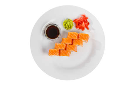 Sushi, rolls, uramaki, philadelphia with salmon, raw seafood, soy sauce, marinated ginger and wasabi, white isolated background, view from above