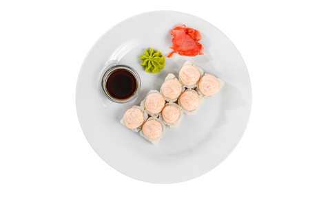 Sushi, rolls, uramaki alaska, lava sauce, tobiko caviar, soy sauce, marinated ginger and wasabi, white isolated background, view from above Stockfoto