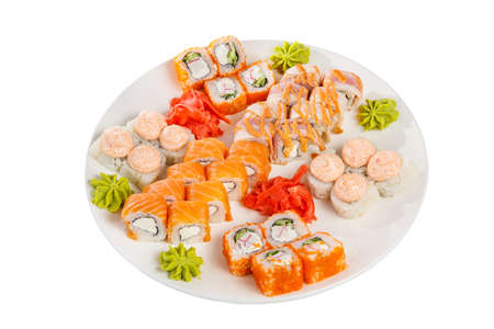 Set of sushi for a large company, rolls, california, philadelphia with lava sauce, ginger and wasabi, white isolated background, view from above 写真素材