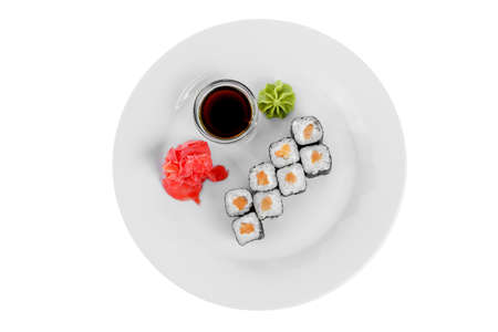 Sushi, rolls, hosomaki with salmon and philadelphia cheese, soy sauce, marinated ginger and wasabi, white isolated background, view from above Stockfoto