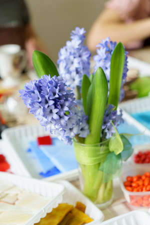 blue hyacinths on the table lifestyle, in the background people, leisure, master class