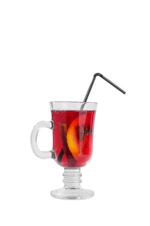 Monochrome transparent cocktail, red mulled wine in a high glass with a handle with spices and a slice of lemon, orange, star anise and vanilla stick, side view, isolated white background