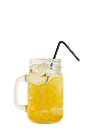 Multicolored, gradient opaque cocktail, cool tea, refreshing in a glass jar with ice cubes, round lemon slices, with a taste of fruits and citrus, straw, Side view, Isolated white background Standard-Bild - 140646676