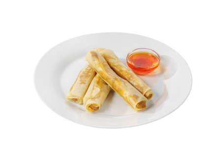 Hot appetizer stuffed pancake on plate with hot red sauce, pepper, fried in oil before alcohol, white isolated background, side view Stock fotó