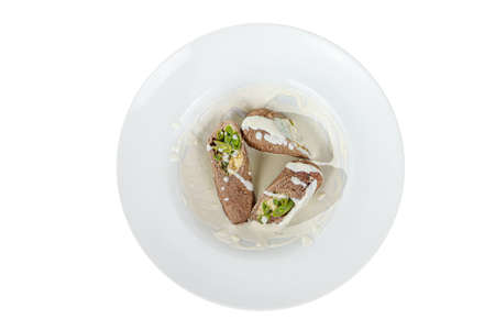 meatloaf, roll with vegetables and cheese stuffing with sour cream sauce on a plate, isolated on a white background. For a menu in the restaurant, bar, view from above