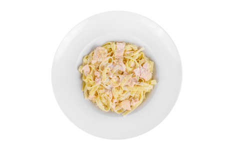 Pasta, noodles with fish, decorated with cheese, isolated white view, from above Serving a meal in a cafe, restaurant.
