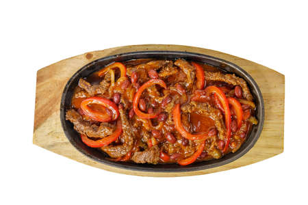 fajita, beans and bell peppers with meat, beef, lamb, goulash, fried, baked portion on a hot frying pan, on a wooden board on white background view from above. For the menu