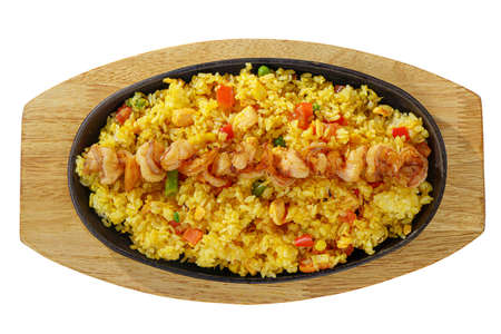 chahan with squid, shrimp, vegetables, serving on a hot frying pan, on a wooden board on white isolated background view from above. For the menu, restaurant, bar, cafe