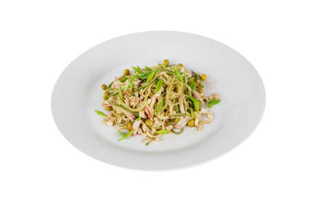 Salad with fuchsozoy, meat, crab meat, squid, pears, green onions, cucumber on plate, white isolated background, view from above, for the menu, restaurant bar cafe Imagens