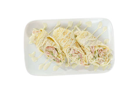 Salad in pita bread, pancake with cucumber, zucchini, egg, cheese, sausage, ham, meat, mayonnaise, sauce, roll on plate, white isolated background, view from above for the menu restaurant bar cafe