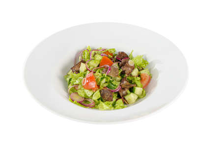 Caesar salad with chicken liver, meat, beef, tomato, onion, cucumber, lettuce on plate, white isolated background Side view. For the menu, restaurant, bar cafe