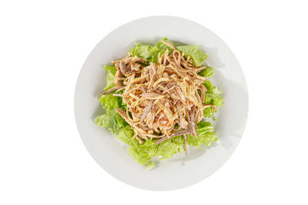 Salad with ham, boiled pork, beef, chicken, pork, egg pancake, lettuce, mayonnaise on plate, white isolated background, view from above, for the menu restaurant bar cafe Imagens