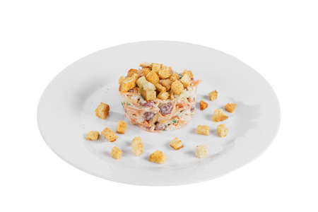 salad with beans, Korean carrots, cucumber, chicken, crackers on plate, white isolated background Side view. For the menu, restaurant, bar, cafe