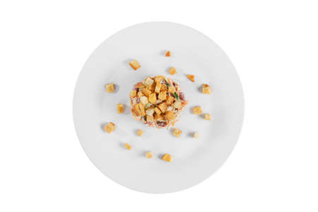 salad with beans, Korean carrots, cucumber, chicken, crackers on plate, white isolated background, view from above. For the menu, restaurant, bar cafe Imagens