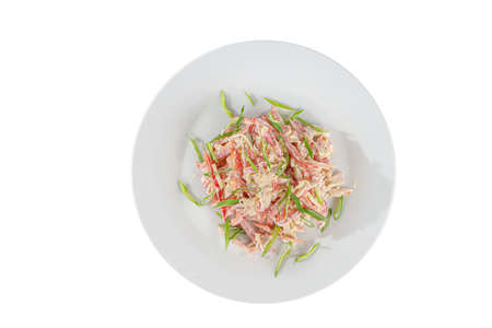 Salad with Bulgarian pepper, meat, chicken, squid, crab sticks, egg, mayonnaise, green onion on plate, white isolated background, view from above, for the menu restaurant bar cafe