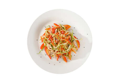 Salad with meat, chicken, pork, pepper, noodles, garlic arrows, green onions, tomato, carrots, zucchini, sesame seeds on plate, white isolated background, view from above for the menu bar cafe