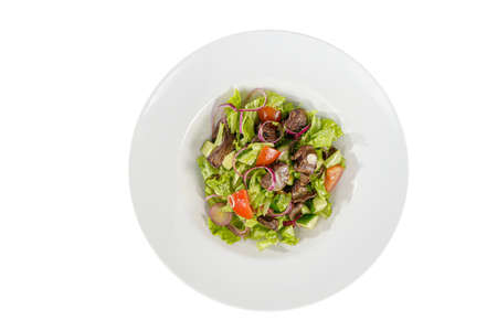 Caesar salad with chicken liver, meat, beef, tomato, onion, cucumber, lettuce on plate, white isolated background, view from above. For the menu, restaurant, bar cafe